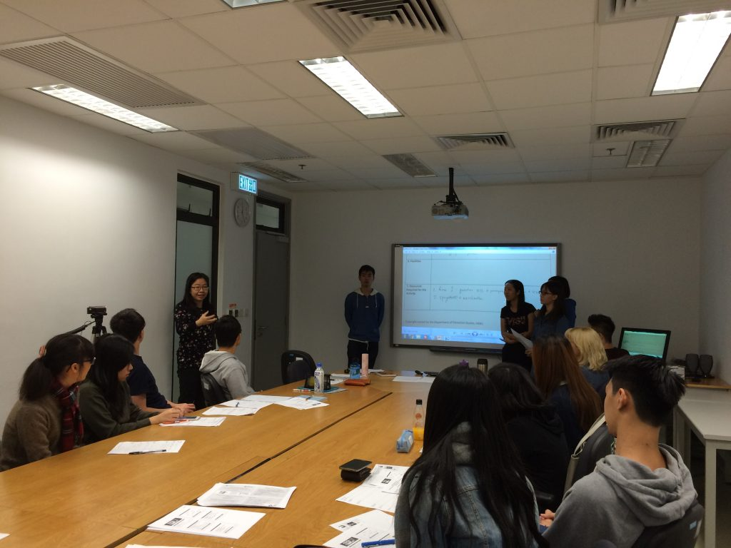 Team members debriefing after small groups of HKBU students presenting